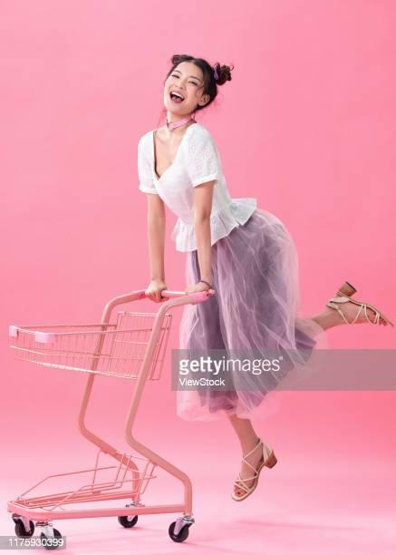 happy girl shopping - china east asia stock-fotos und bilder