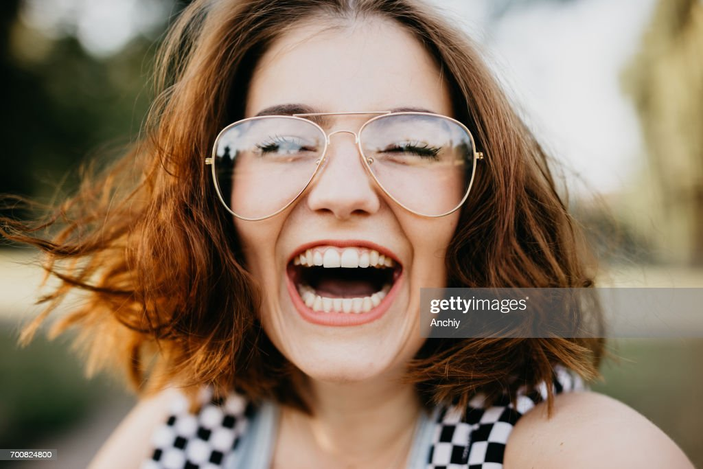 Happy girl smiling at the camera : Stock Photo
