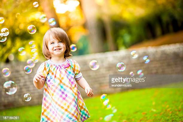 Happy Girl Standing Around Bubbles