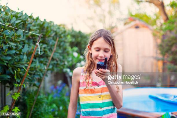 happy girl using a walkie talkie - radio stock pictures, royalty-free photos & images