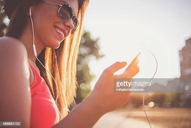 Happy girl using smartphone