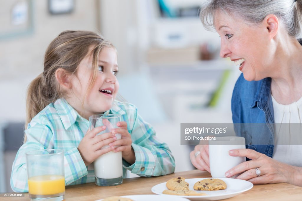 Happy girl visits with grandma : Stock Photo