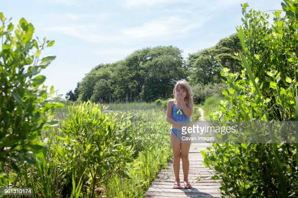 happy girl wearing swimwear and standing on boardwalk - cape may stock pictures, royalty-free photos & images