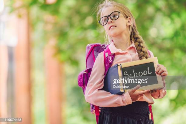 little girl with backpack outdoors
