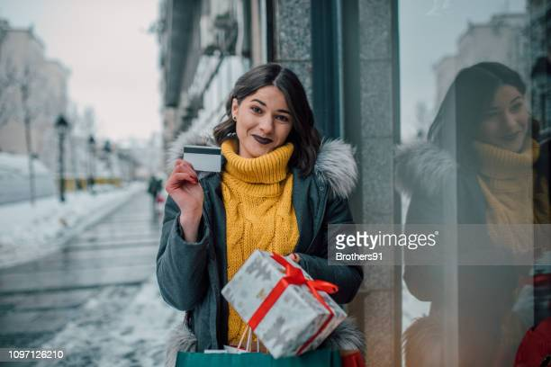 happy girl with a credit card - charging sports stock pictures, royalty-free photos & images