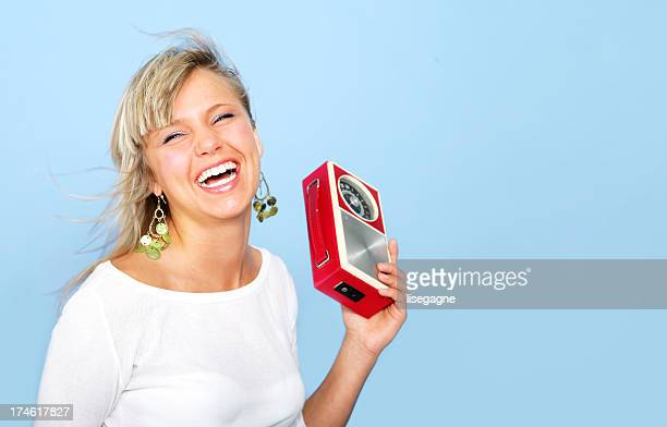 Happy girl with a radio