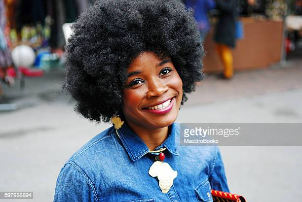 happy girl with big afro hair. - big beautiful black women stock photos and pictures