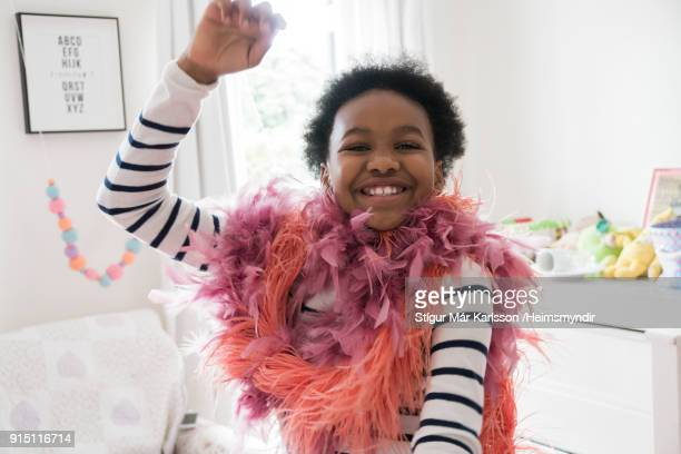 happy girl with boas dancing at home - boa stock pictures, royalty-free photos & images