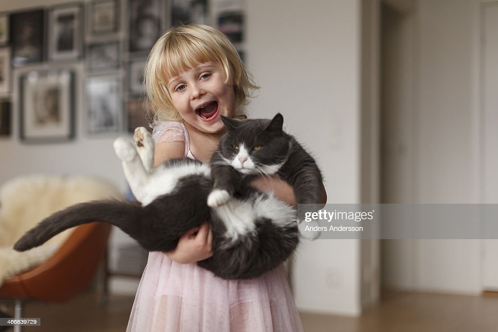 Happy girl with cat : Stock Photo