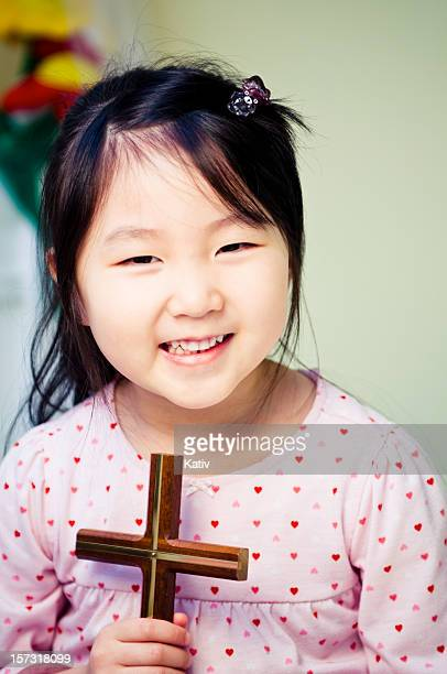 happy girl with cross - x photos stock photos and pictures