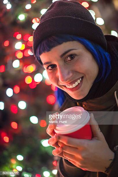 Happy girl with cup of coffee