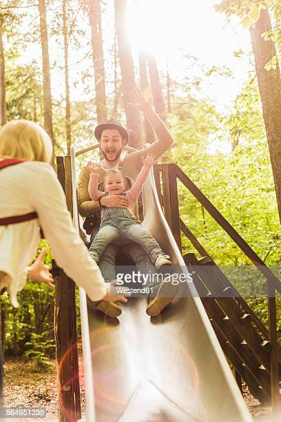 Happy girl with father on a slide
