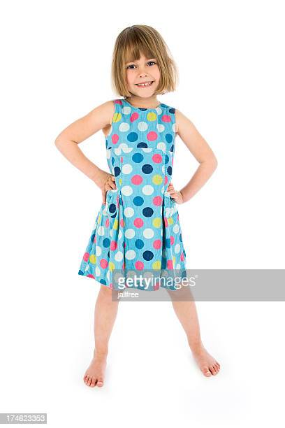 Happy girl with hands on hips on white background