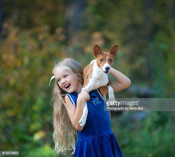Happy girl with her dog