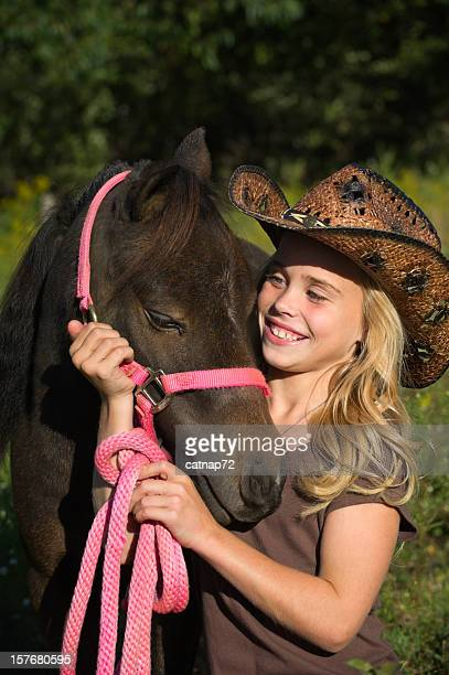 Happy Girl with Horse, Cowboy Hat and Pink Tack
