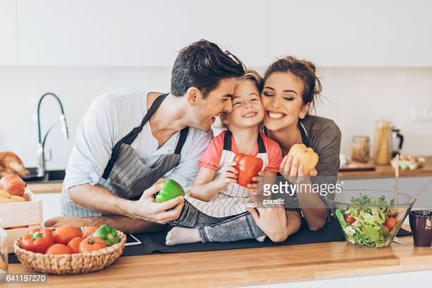 happy girl with mom and dad in the kitchen - love you stock photos and pictures