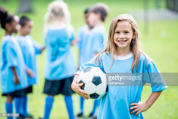 happy girl with soccer ball - the championship football league stock pictures, royalty-free photos & images