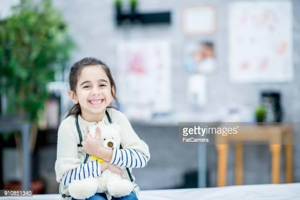 Happy Girl With Teddy Bear