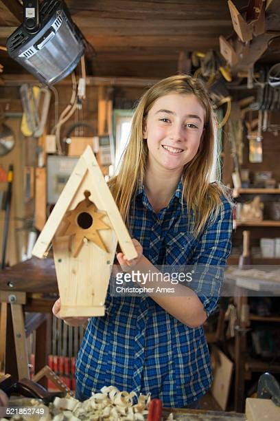 happy girl with wooden birdhouse project - birdhouse stock photos and pictures