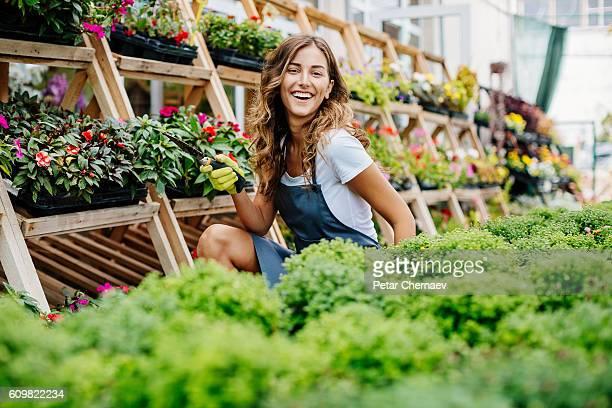Happy girl working in a garden center