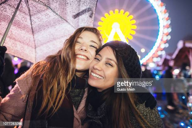 happy girlfriends at christmas market. - annual event stock pictures, royalty-free photos & images