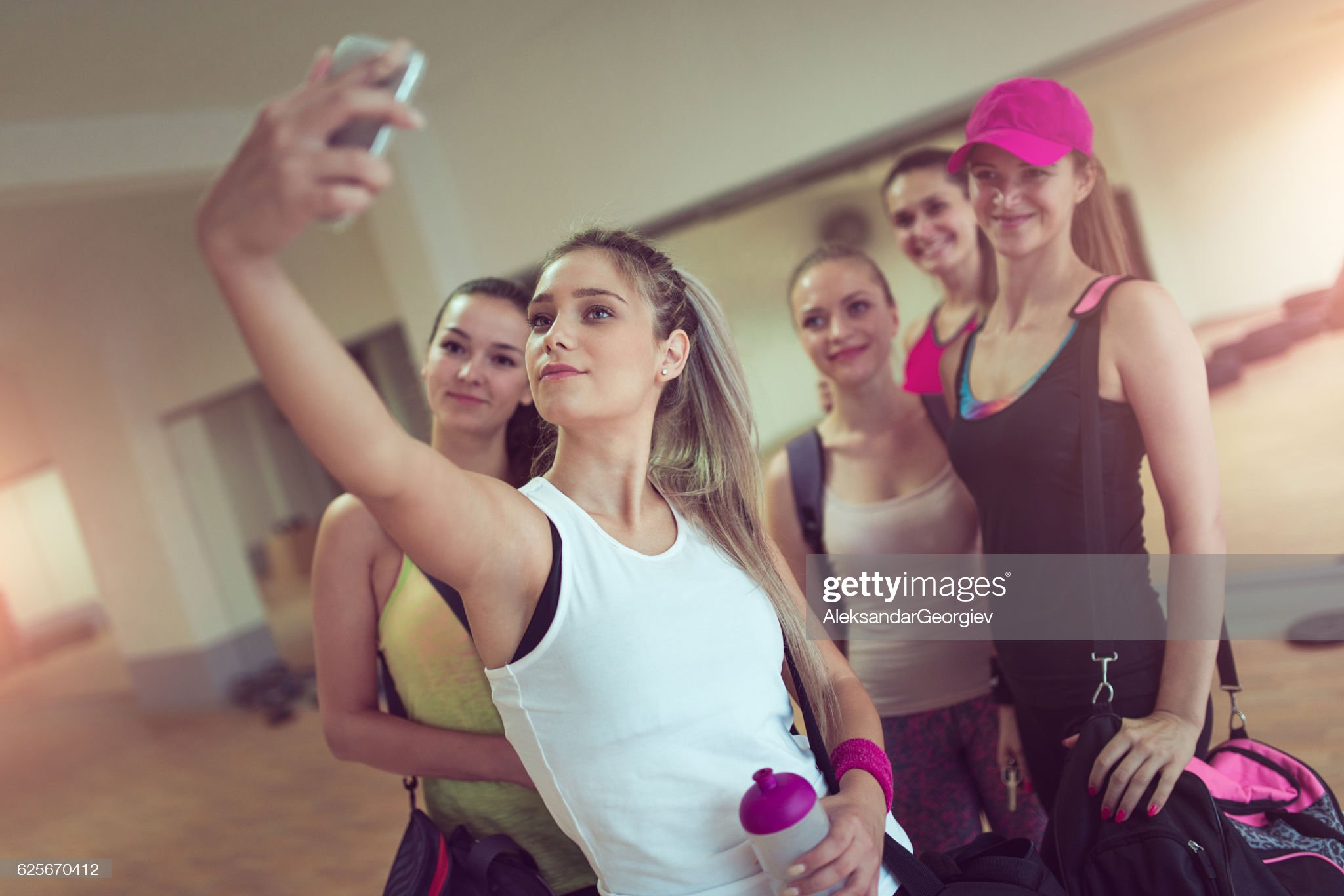 Happy Girlfriends Group Taking Selfie in Gym after Exercise : Stock Photo