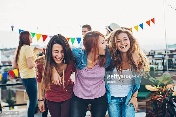 Happy girlfriends on a party