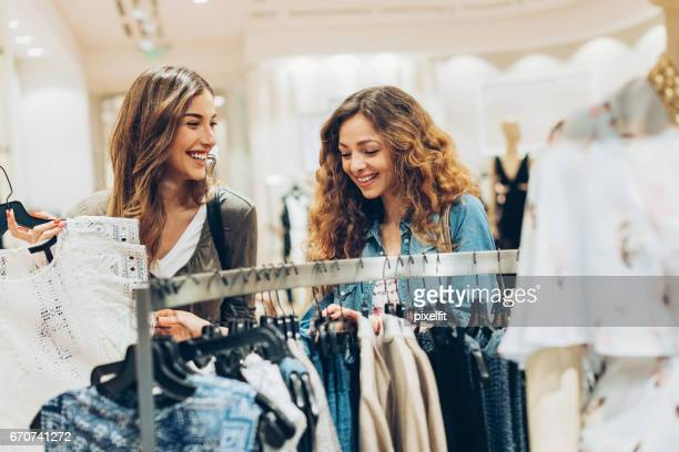 Happy girlfriends shopping together