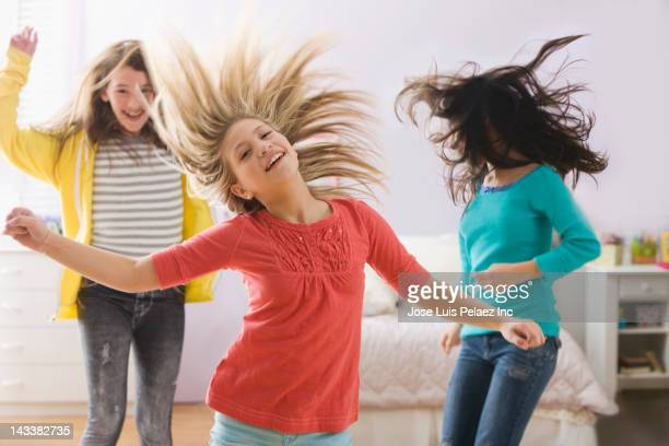 Happy girls dancing