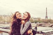 Happy girls enjoying Paris together