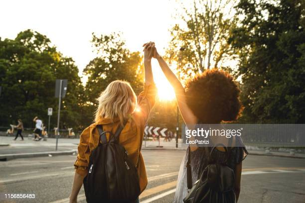 happy girls going to a concert in milano - caucasian ethnicity stock pictures, royalty-free photos & images