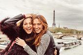 Happy girls in Paris against the Eiffel tower