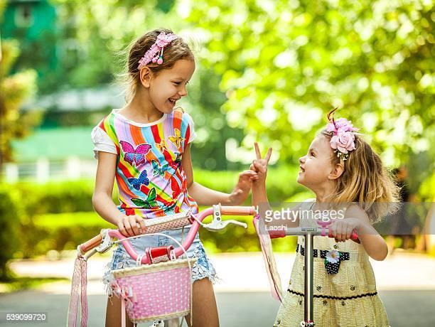 Happy Girls Riding Bikes