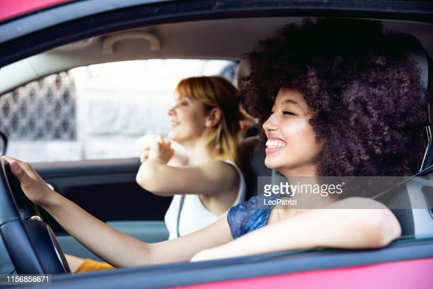 happy girls spending a day off together - driving stock pictures, royalty-free photos & images