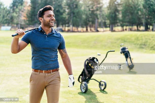 happy golf player - khaki trousers stock pictures, royalty-free photos & images