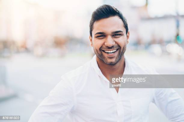 Happy good looking man in white shirt