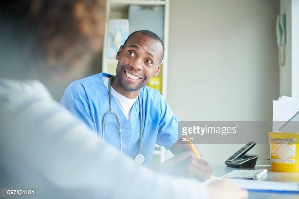 happy gp consultation - emergency medicine stock pictures, royalty-free photos & images