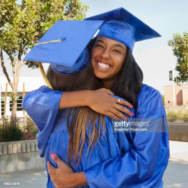 Happy graduates hugging