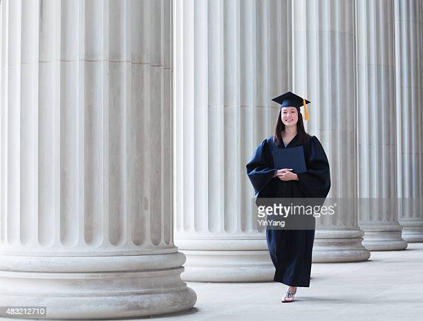 Happy Graduating Young Woman Student Walking on College Campus Horizontal