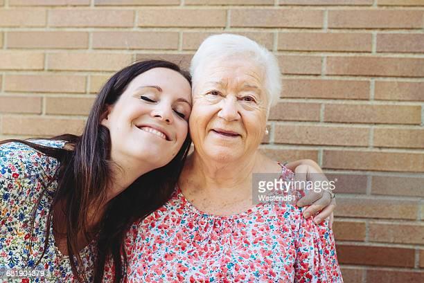 Happy granddaughter embracing her grandmother