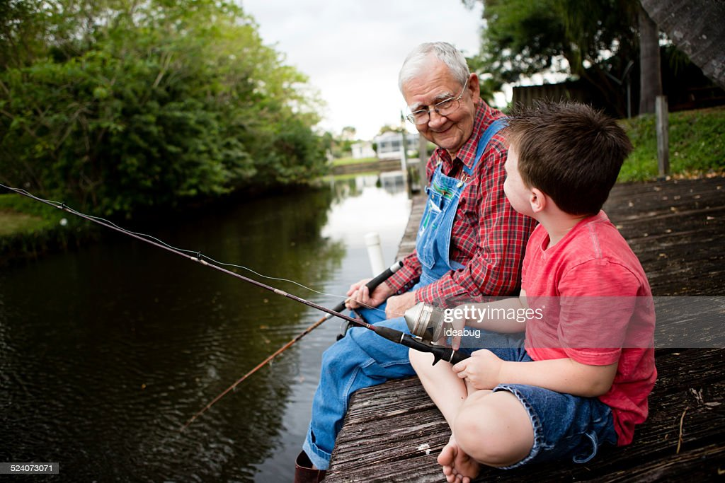 Happy Grandfather and Great Grandson Fishing Together : Stock Photo