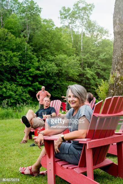 Happy grandmother having all her family relaxing in summer camping.
