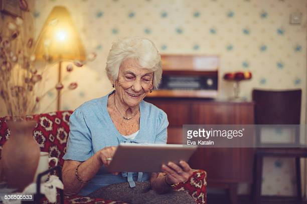 Happy grandmother using a tablet