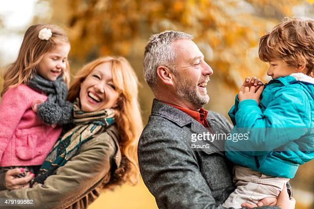 Happy grandparents and grandchildren having fun outdoors.