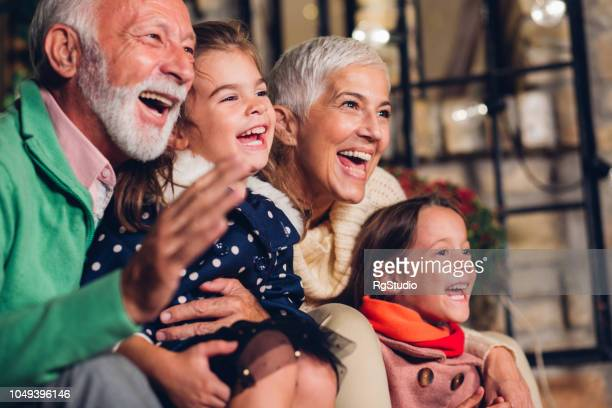 happy grandparents with grandchildren - december stock pictures, royalty-free photos & images
