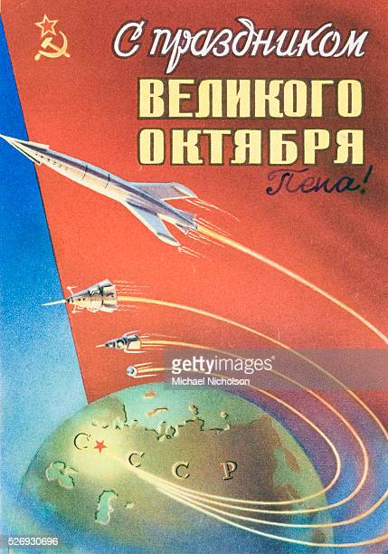 Happy Great October Festival Poster celebrating the anniversary of the Russian Revolution of October 1917 Shows rockets Sputniks and other spacecraft...