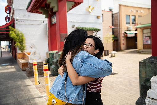 Happy greetings of young women in Chinatown - gettyimageskorea