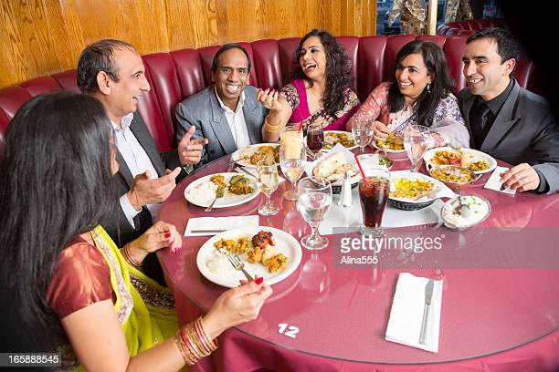 Happy Group Of Adult Friends At An Indian Restaurant