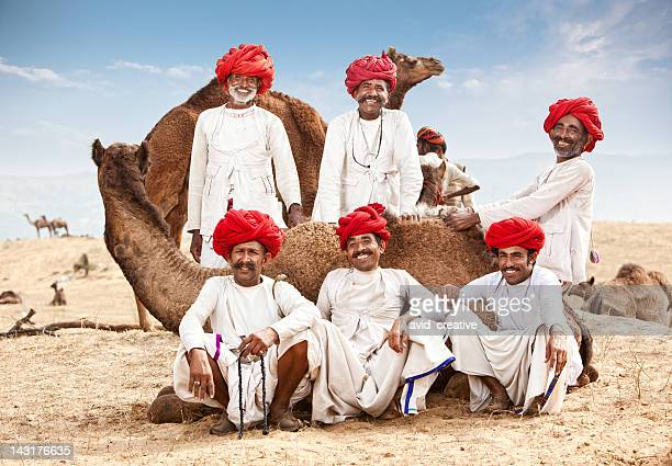 happy group of camel drivers - pushkar stock pictures, royalty-free photos & images