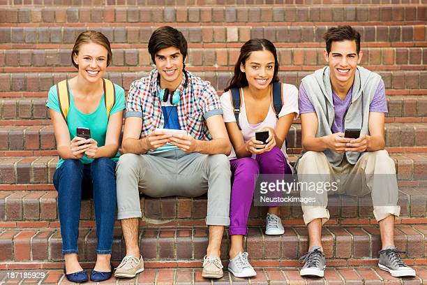 Happy Group Of College Students With Smart Phones